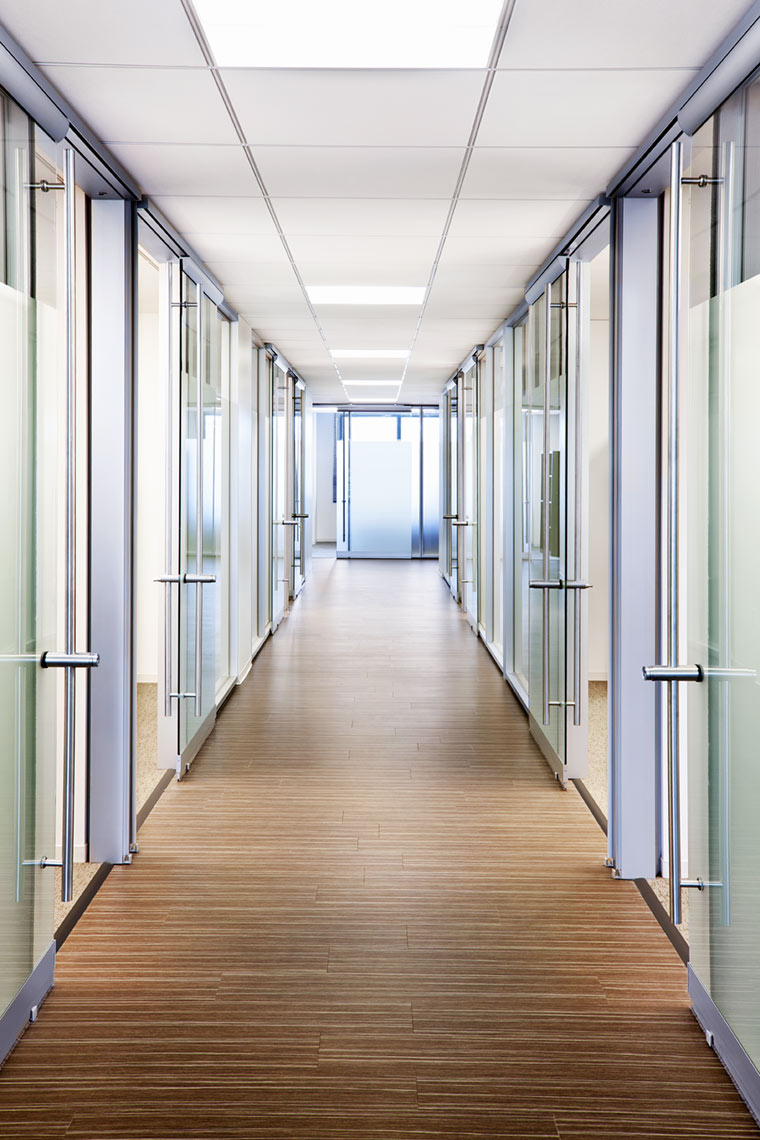 architectural photograph of an office interior with glass doors by Dan Poyourow