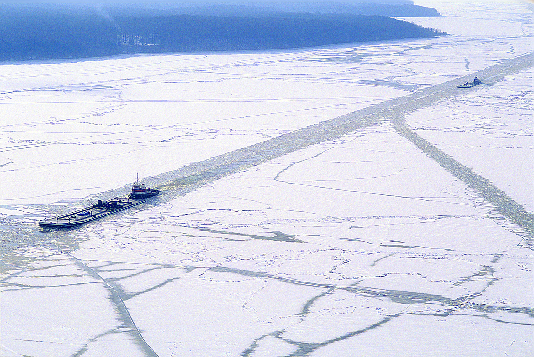 Ice breaker and tanker going through the Potomac River